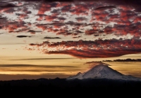 An unusually clear Seattle morning highlights Mt. Rainier, with it's windblown peak and clouds taking on the early reds of the western sunrise.