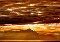 Mt. Spur on the Kenai Peninsula of Alaska rises above Cook Inslet in this colorful fall sunset; the closest active Volcano to Anchorage.